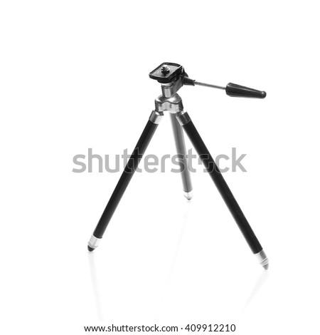 small black old photo camera telescope tripod isolated on white - stock photo