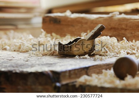 .Small Block Plane and Wood on work bench with shavings - stock photo