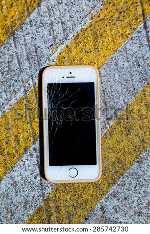 smart phone  ,yellow line on the road texture  - stock photo
