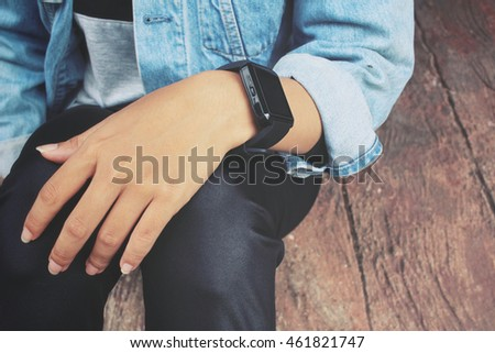 Smartwatch on hand with jeans jacket
