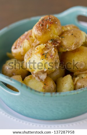 """""""Smashed"""" potatoes that have been cooked in stock. - stock photo"""