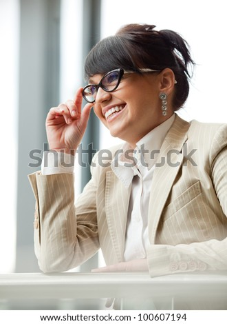 Smiled fashion woman in shopping mall. - stock photo
