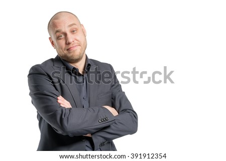 Smiling bald man in a gray suit with arms crossed. Isolated - stock photo