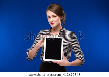 smiling girl with a tablet in hands  - stock photo