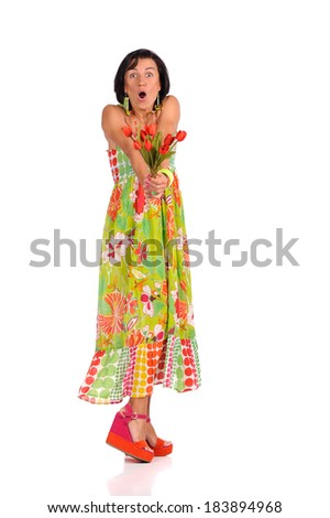 Smiling girl with tulips in the hands isolated over white background