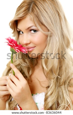 smiling woman with a flower - stock photo