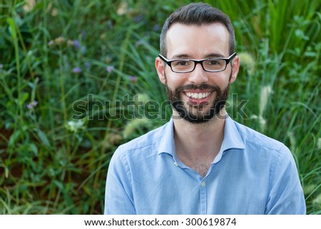 Smiling Young Businessman Wearing Eyeglasses - stock photo