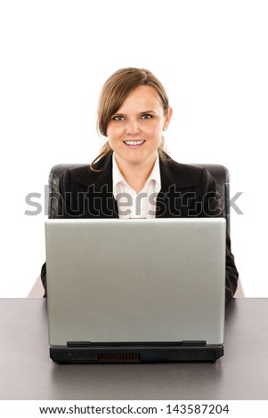 Smiling young businesswoman working at her computer isolated on white background