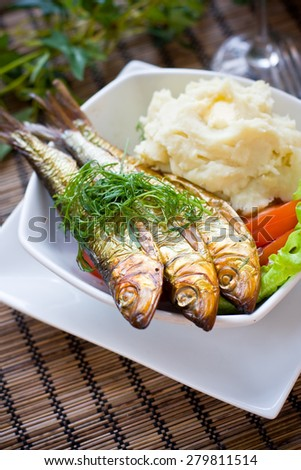 Smoked herring and mashed potatoes - stock photo