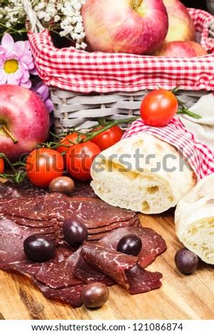 Smoked prosciutto. Selective focus - stock photo