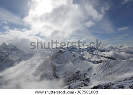 Snow-covered mountain, clouds