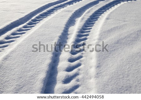 snow-covered road in winter, snow track closed, the rest of the passing cars - stock photo