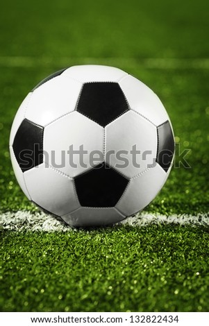 soccer ball on field - stock photo