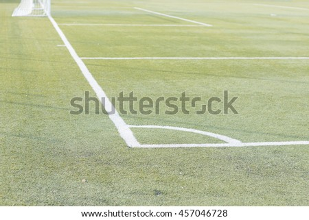 soccer field with white stripe conner