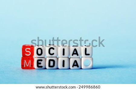 Social Media on red an white  dices on  blue background - stock photo