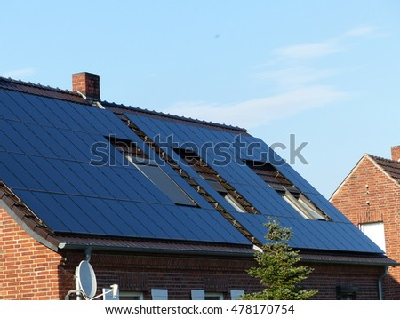Solar collector on the roof of a residential building. Electricity from sunlight.