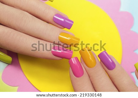 Solar manicure colored varnishes rectangular shaped nails. - stock photo