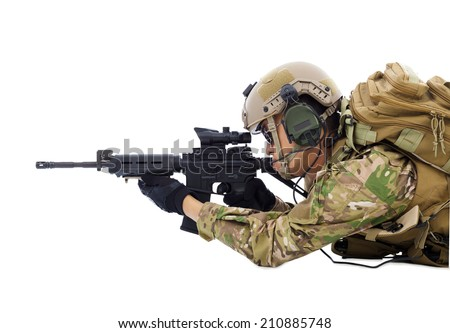 soldier holding rifle or sniper lying on the floor - stock photo