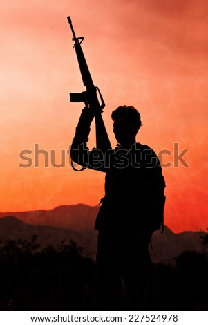 soldier with firearm in silhouette