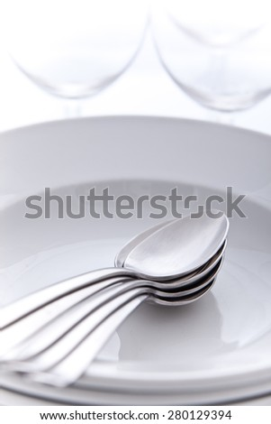 Soup spoons and plates - stock photo