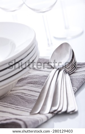 Soup spoons and plates