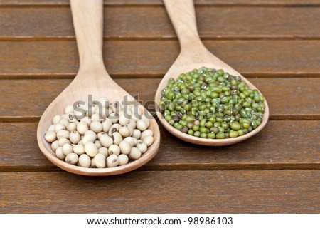 Soy beans and green beans on teak table