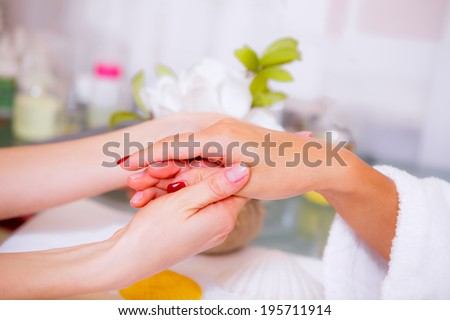 spa treatments for hands, hand care, health and beauty of hands, the girl in a beauty salon - stock photo