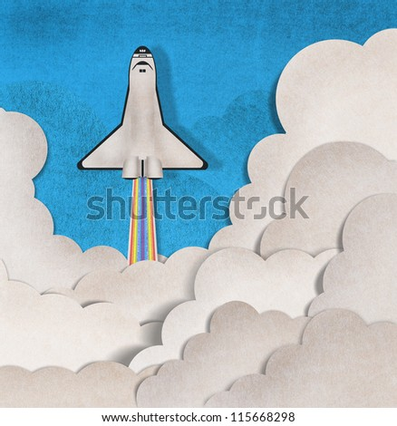 spacecraft and white cloud recycled paper craft on background - stock photo
