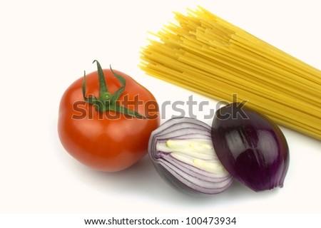 Spaghetti, tomato, red onion - stock photo