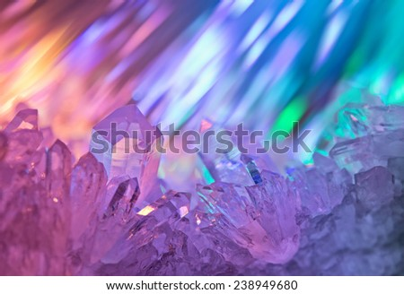 Sparkling multi-colored background with rays of light and crystals of rock crystal.  - stock photo
