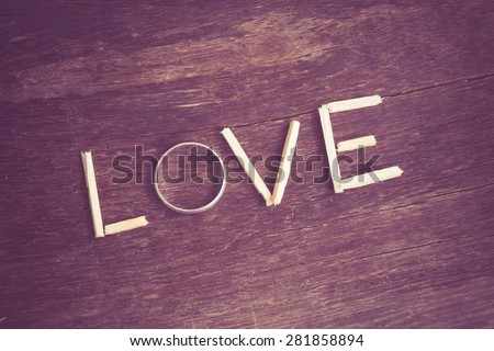 spelling  Love with ring and wood with filter effect retro vintage style - stock photo