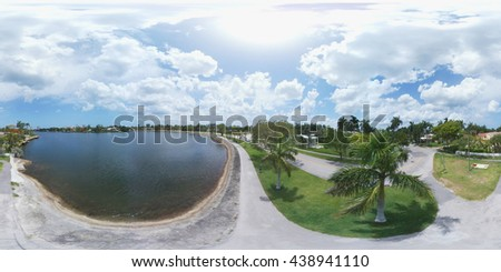 360 spherical photo of a walkway by the lake - stock photo