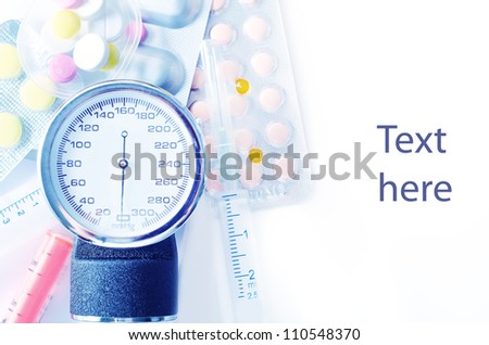 sphygmomanometer and pills - stock photo