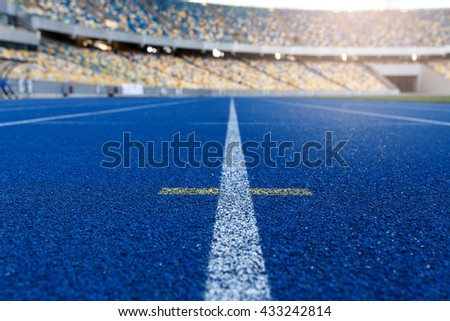 sport and lifestyle concept. Running track in stadium - stock photo