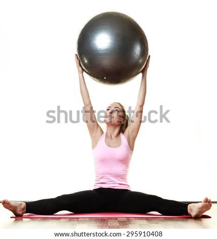 sport, training, gym and lifestyle concept. Young happy woman doing fitness exercises with fit ball isolated on white