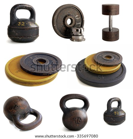 Sports equipment: the weight of 32 kg, 16 kg, disks, a dumbbell on a white background. Isolate.                              - stock photo
