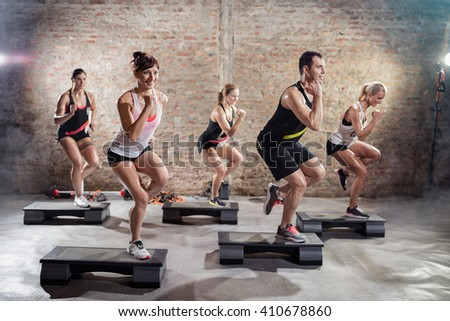 Sporty people on training on steppers, power step  - stock photo