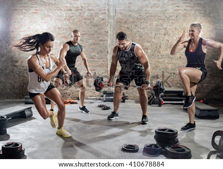 sporty people  practicing with weights, high intensity training  - stock photo