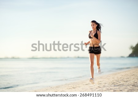 Sporty woman jogging on seaside, beautiful morning  - stock photo