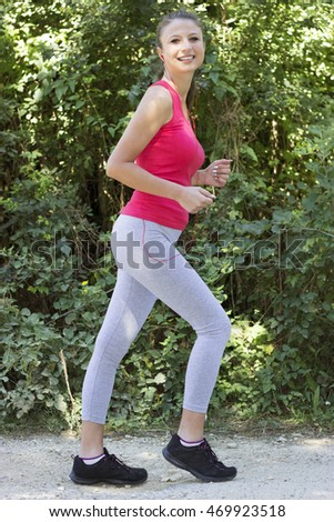 sporty young woman listening to music while you exercise outdoors