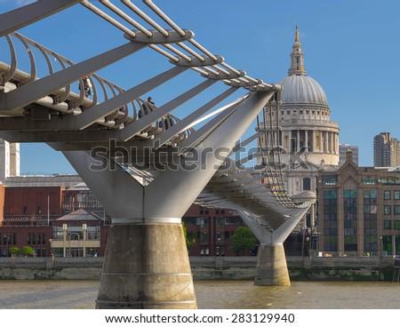 St Pauls and Millennium bridge in London,UK. - stock photo