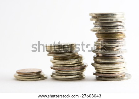 3 stacks of coins showing progress and growth - stock photo