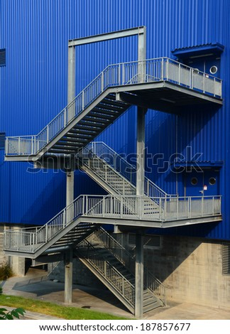 stairs on the outside of blue building