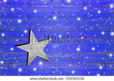Star on weathered blue wooden board