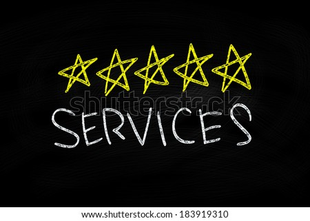 5 Stars Services writing, written with Chalk on Blackboard - stock photo