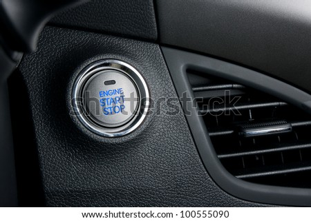 Start stop engine button with blue letters - stock photo