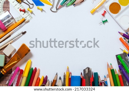 stationery objects on wooden background - stock photo