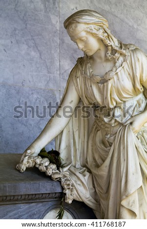 Statue of a woman in sorrow