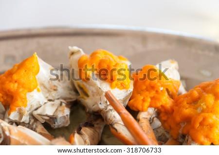 steamed crab and juicy egg  with thai lime and spicy sauce.Selective focus. Very shallow Depth of Field, for soft background.