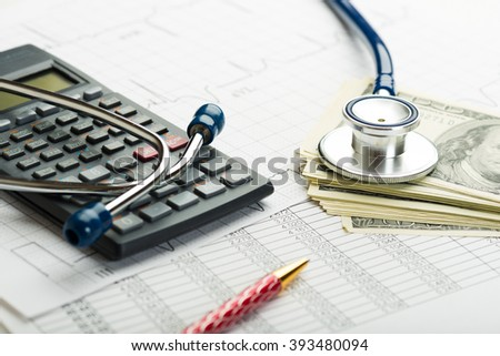 Stethoscope and calculator symbol for health care costs or medical insurance